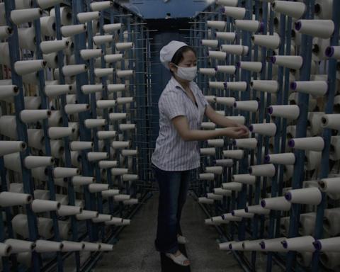 Ouvrière dans une usine textiles, Vietnam. Photo (c) DR